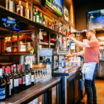 bar photography of bartender pouring beer at mackenzie river pizza co in butte montana