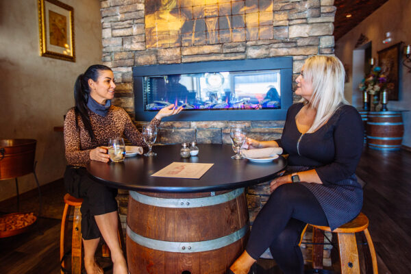 restaurant photography of two women having dinner at la casa toscana in butte montana