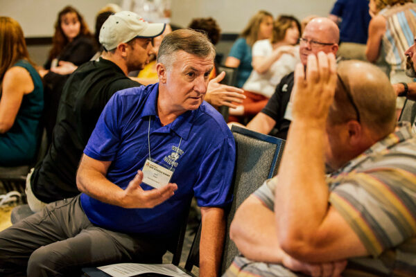 event photography of group of educators talking during a breakout session in butte montana